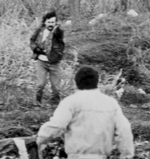 Stone carrying out his attack at Milltown Cemetery in March 1988