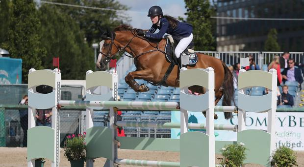Top pony: Niamh McEvoy on her way to winning the 148cm class