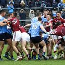 No holds barred: Clashes between Galway and Dublin (pictured) and Tyrone against Monaghan are usually full of rough and tumble