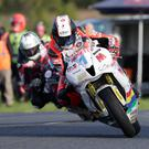 Speed king: Connor Cummins on his way to Supersport victory at Dundrod ahead of Adam McLean