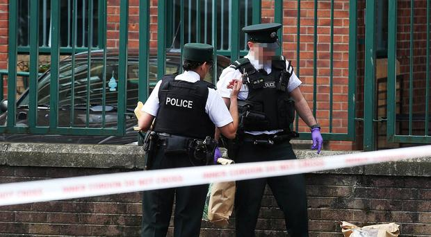 Police attend the scene of a assault in the New Lodge Road area of north Belfast on Friday morning. Pic Pacemaker