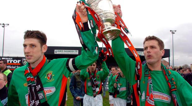 Good times: Paul Leeman and Colin Nixon lift the Premiership title in their Glentoran playing days in 2005