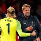 Distant: Reds boss Jurgen Klopp and Loris Karius this week