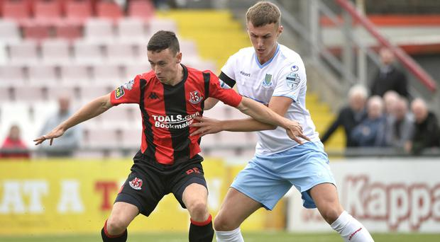 Crusaders Paul Heatley in action with Ballymena's Scot Whiteside