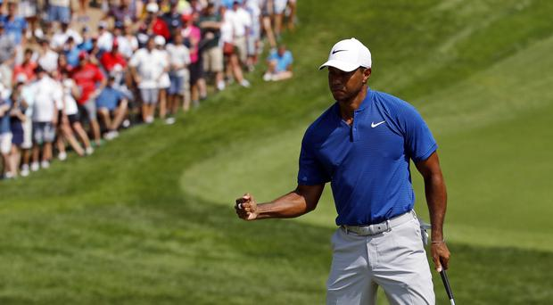 Tiger Woods remains in contention in St. Louis (Charlie Riedel/AP)