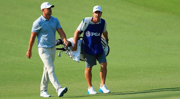 Portrush caddy Ricky Elliott has helped Brooks Koepka to his third major title at the US PGA Championship.
