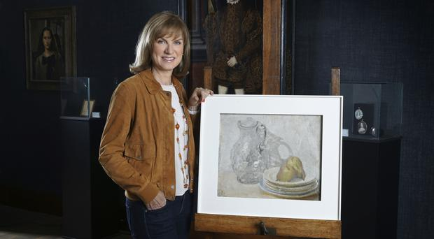 Fiona Bruce with the painting (Rolf Marriott/BBC)