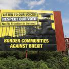Anti Brexit billboards on the northern side of the border between Newry in Northern Ireland and Dundalk in the Republic of Ireland as new statistics are released about cross-border trade. Niall Carson/PA.
