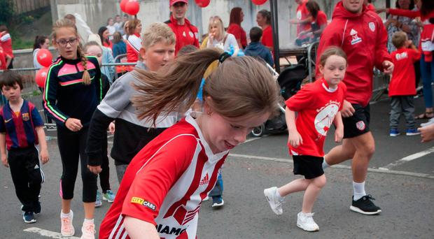 Children taking part in a street football match in the Brandywell with Derry City players yesterday afternoon as part of the Ryan McBride Day