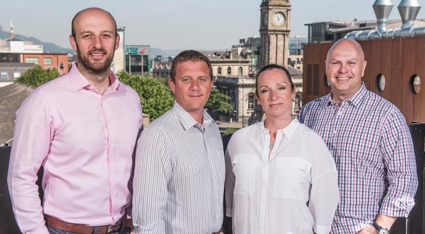 L-R: Analytics Engines CTO Dr Alastair McKinley, SmashFly site lead Gareth McCullough, Analytics Engines CEO Dr Aislinn Rice, and SmashFly CEO Thom Kenney.