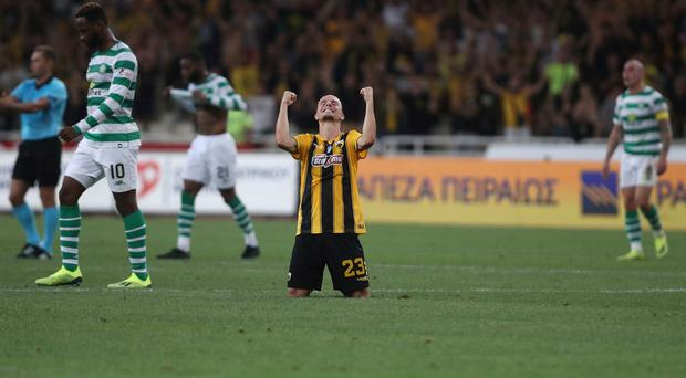 AEK Athens' Niklas Hult, center, celebrates on the pitch after his team won a Champions League third qualifying round (AP Photo/Petros Giannakouris)