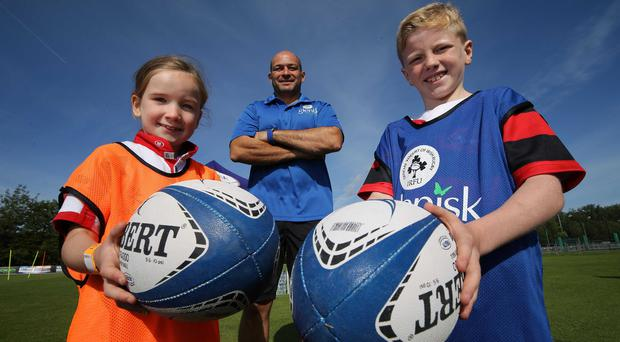 Fine mentor: Ireland and Ulster star Rory Best with budding young players Cicely Blair (7) from Carrickfergus and Evan McIlvanna (8) from Newry at the Glenisk Kids' Rugby Training Camp at Stormont