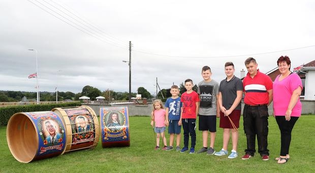 Kelley Sterritt and her six children with their Lambeg drums