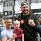 Fan favourite: Tyson Fury poses with fans before his press conference ahead of his fight on Saturday with Francesco Pianeta