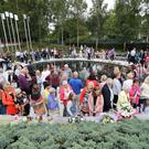 People visit the Omagh Memorial Garden after attending the ceremony for victims (Niall Carson/PA)