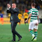 Heartbreak: Brendan Rodgers salutes the fans after Celtic's Champions League exit against AEK Athens in Greece