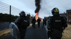 Police were ordered to remove the Bloomfield Walkway bonfire in east Belfast. Photo by Kelvin Boyes / Press Eye.