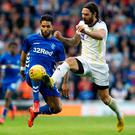 At a stretch: Rangers' Daniel Candeias aims to nip in ahead of NK Maribor ace Marko Suler