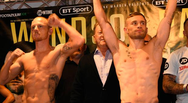 Bring it on: Carl Frampton and Luke Jackson show they mean business ahead of tonight's Windsor Park bout as the stadium takes shape