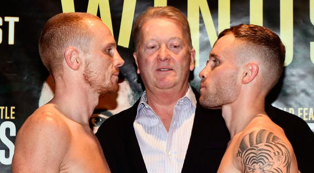Staring it up : Carl Frampton (right) at big fight weigh in with Luke Jackson at Europa Hotel
