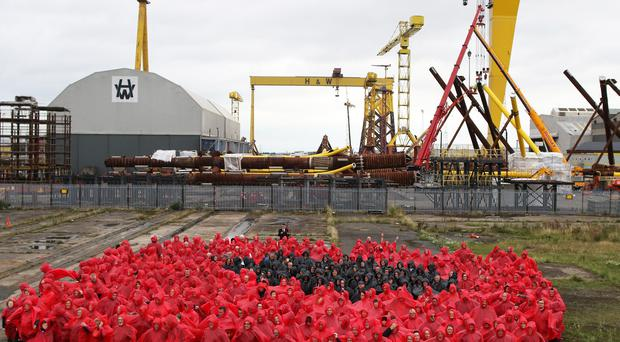 Hundreds gather to attempt human poppy record break in titanic world record attempt in the titanic quarter in east belfast for the largest poppy created using mightylinksfo