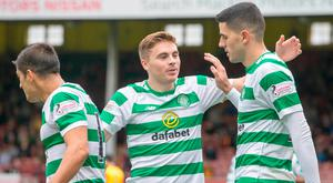 Celtic's Tom Rogic (right) celebrates scoring his side's third goal of the game against Partick Thistle.