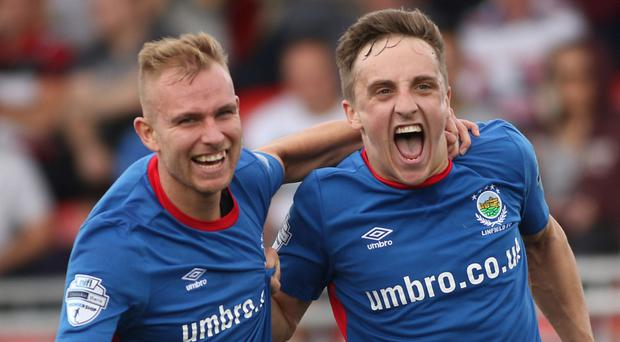Linfield's Joel Cooper (right) celebrates with Andrew Mitchell after netting earlier this season.