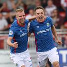 Linfield's Joel Cooper (right) celebrates with Andrew Mitchell after netting at Seaview.