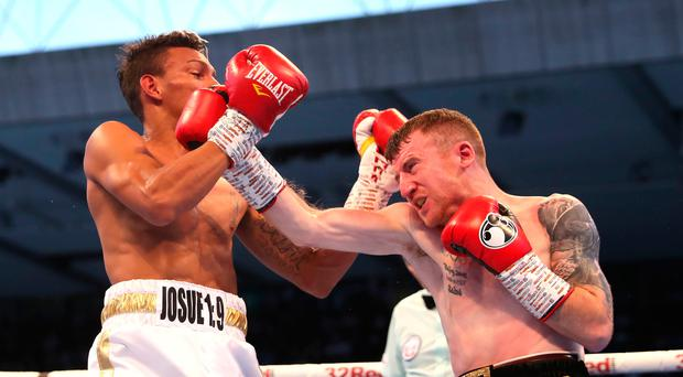 Toe to toe: Cristofer Rosales battles with Paddy Barnes at Windsor Park