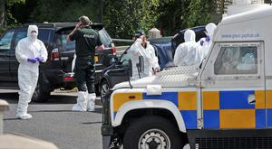 Police sealed off the street in Eglinton as forensic experts move in to examine a bomb left under a car - Police said the a bomb left under a serving police officer's car near Londonderry was a