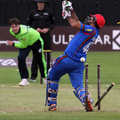 Cleaned out: Josh Little bowls Afghanistan captain Ashgar Afghan at Bready yesterday