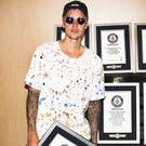 Justin Bieber with eight of his official Guinness World Records certificates (GWR/PA)
