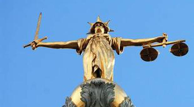 A Belfast woman was remanded in custody on Tuesday accused of having a sword in public.