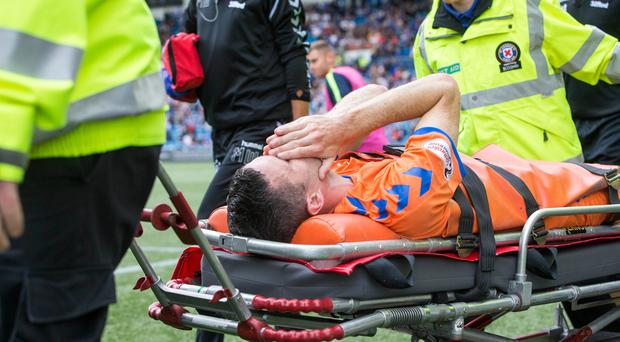 Rangers Jamie Murphy is stretchered off the pitch with an injury during the Betfed Cup Second Round match at Rugby Park