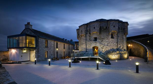Athlone's Norman castle, built in 1210, lit up at night.