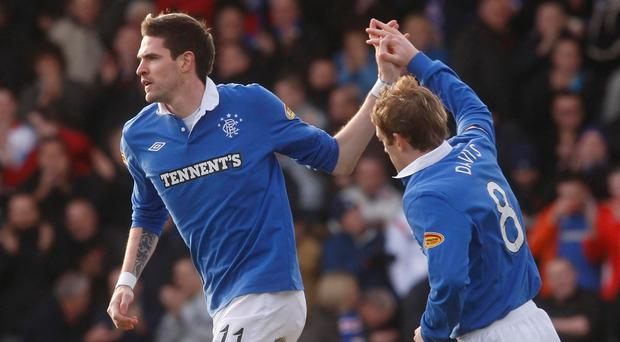 Goal getter: Kyle Lafferty celebrates with fellow Ulsterman Steven Davis after scoring for Rangers at St Mirren in 2010