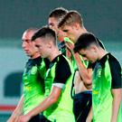 Work to do: Celtic skipper Scott Brown leads his team off in Lithuania last night