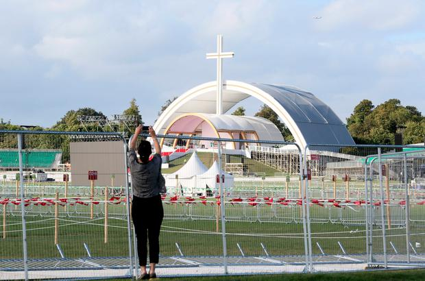 A woman takes a photograph of the Papal Altar at Phoenix park in Dublin on August 23, 2018, prior to the visit by Pope Francis to Ireland on August 25-26. Pic Paul Faith PA