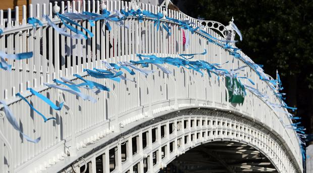 Blue ribbons are tied to Ha'Penny Bridge in Dublin to remember the victims of clerical sex abuse ahead of the start of the visit to Ireland by Pope Francis (Niall Carson/PA)