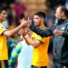 Wolves manager Nuno Espirito Santo with players Ruben Neves and Raul Jimenez after their draw with Manchester City.