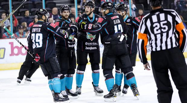 The Giants celebrate their second goal, scored by Curtis Leonard