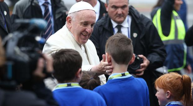Pope Francis blesses schoolchildren as he arrives at Ireland West Airport in Knock, Co Mayo (Yui Mok/PA)