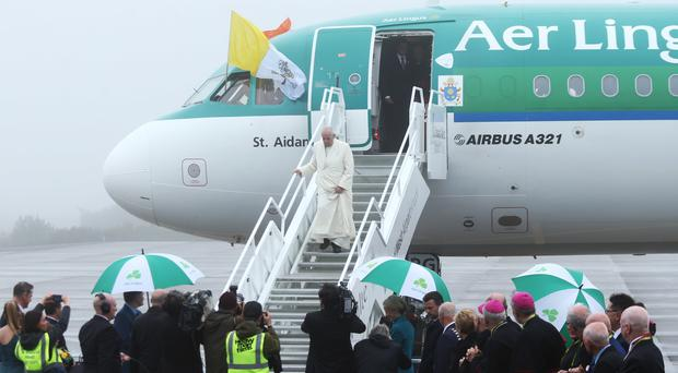Pope Francis is greeted by a delegation of clergy and representatives from Ireland West Airport (Yui Mok/PA)