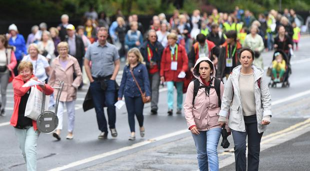 Early pilgrims arrive at Phoenix Park (Joe GIddens/PA)