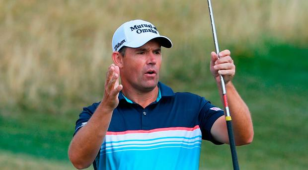 So close: Padraig Harrington reacts to a shot yesterday
