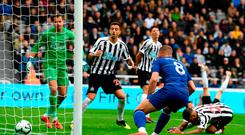 Costly mistake: Newcastle's Deandre Yedlin (grounded) deflects the ball into his own net for Chelsea's winning goal