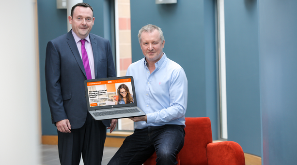 Connor McCann, owner of easyConveyance.com with Kevin McShane of Fermanagh and Omagh District Council