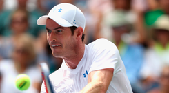 Old routine: Andy Murray returns during his first-round victory at the US Open