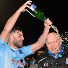 Champagne moment: Johnny McMurray celebrates with David Jeffrey after Ballymena United's League Cup triumph in 2017