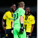 Sheer joy: Burton players celebrate after Villa's penalty is saved